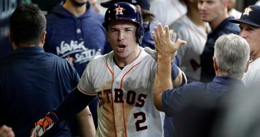 Houston Astros' Alex Bregman (2) celebrates after hitting a solo home run against Cleveland Indians' pitcher Trevor Bauer during the seventh inning of Game 2 of a baseball American League Division Series, Saturday, Oct. 6, 2018, in Houston.