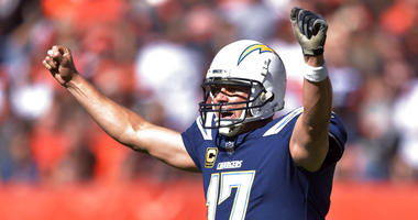 Los Angeles Chargers quarterback Philip Rivers celebrates a touchdown in the first half during an NFL football game against the Los Angeles Chargers, Sunday, Oct. 14, 2018, in Cleveland. (AP Photo/David Richard)