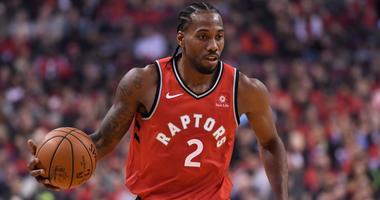Toronto Raptors forward Kawhi Leonard (2) takes the ball up court against the Cleveland Cavaliers during first half NBA basketball action in Toronto on Wednesday, Oct. 17, 2018.