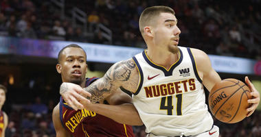 Denver Nuggets' Juan Hernangomez (41) drives around Cleveland Cavaliers' Rodney Hood (1) during the second half of an NBA basketball game Thursday, Nov. 1, 2018, in Cleveland. The Nuggets won 110-91.(AP Photo/Tony Dejak)