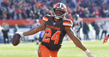 Cleveland Browns running back Nick Chubb celebrates after scoring a 92-yard touchdown in the second half of an NFL football game against the Atlanta Falcons, Sunday, Nov. 11, 2018, in Cleveland. (AP Photo/David Richard)