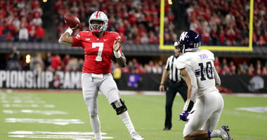 Ohio State quarterback Dwayne Haskins (7) throws as Northwestern defensive back Alonzo Mayo (10) defends during the second half of the Big Ten championship NCAA college football game, Saturday, Dec. 1, 2018, in Indianapolis. (AP Photo/Michael Conroy)
