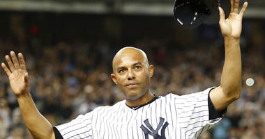 File-This Sept. 26, 2013, file photo shows New York Yankees relief pitcher Mariano Rivera acknowledging the crowd's standing ovation after coming off the mound in the ninth inning of his final appearance in a baseball game in New York. Rivera has become b