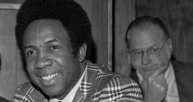his June 19, 1996, file photo shows Frank Robinson at a news conference in Cleveland, Ohio, after being named Major League Baseball's first black manager, with the Cleveland Indians. In the background is baseball commissioner Bowie Kuhn. Hall of Famer Fra