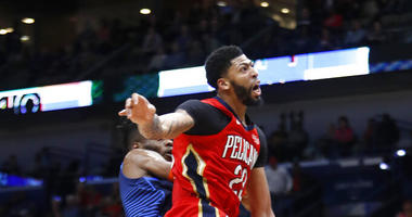 New Orleans Pelicans forward Anthony Davis (23) collides with Oklahoma City Thunder forward Nerlens Noel (3)