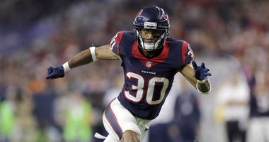 FILE - In this Aug. 22, 2015, file photo, Houston Texans' Kevin Johnson (30) chases a play during the first half of an NFL preseason football game against the Denver Broncos in Houston. Johnson is scheduled to meet with the Browns, a person familiar with