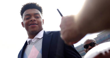 FILE - In this Sept. 29, 2018, file photo, Georgia quarterback Justin Fields enters Sanford Stadium before an NCAA college football game against Tennessee in Athens, Ga. New Ohio State quarterback Fields says he is ready for the hype and expectations that