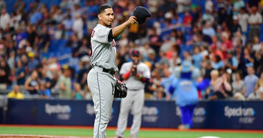 ST PETERSBURG, FLORIDA - SEPTEMBER 01: Carlos Carrasco #59 of the Cleveland Indians tips hit hat to manager Terry Francona #77 before the seventh inning during action against the Tampa Bay Rays at Tropicana Field on September 01, 2019 in St Petersburg, Fl