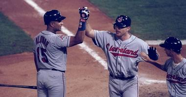 18 Oct 1997: First baseman Jim Thome and catcher Sandy Alomar of the Cleveland Indians high five each other during game one of the World Series against the Florida Marlins at Pro Player Park in Miami, Florida. The Marlins won the game 7-4.