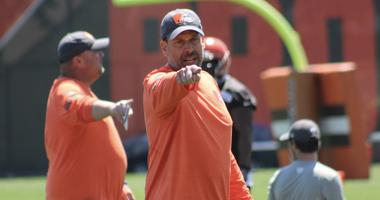 Browns offensive coordinator Todd Haley yells instructions during practice
