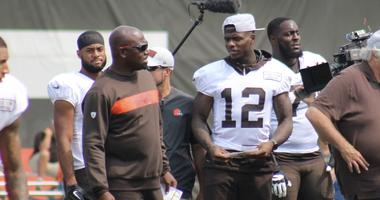 Browns receiver Josh Gordon chats with receivers coach Adam Henry during a practice on Aug. 19, 2018
