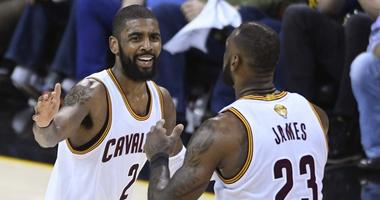 Cleveland Cavaliers guard Kyrie Irving (2) celebrates with forward LeBron James (23) during the third quarter against the Golden State Warriors in game three of the 2017 NBA Finals at Quicken Loans Arena.