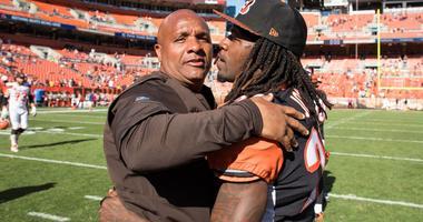 Cleveland Browns head coach Hue Jackson hugs Cincinnati Bengals cornerback Adam Jones (24) after the game at FirstEnergy Stadium.