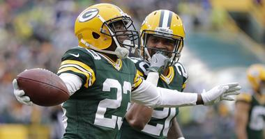 File photo of cornerback Damarious Randall (23) celebrates after an interception with cornerback Kevin King (20) against the New Orleans Saints during the first half at Lambeau Field.