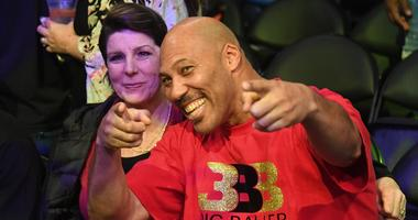 LaVar Ball (right) poses for cameras with his wife Tina (left) before game involving their son Los Angeles Lakers guard Lonzo Ball (not pictured) against the Golden State Warriors at Staples Center.