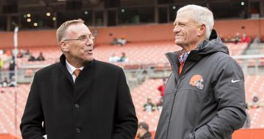 Cleveland Browns general manager John Dorsey, left, talks with team owner Jimmy Haslam during warmups before the game against the Green Bay Packers at FirstEnergy Stadium.