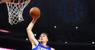 Los Angeles Clippers forward Sam Dekker (7) dunks the ball in the first half of the game against the Sacramento Kings at Staples Center.