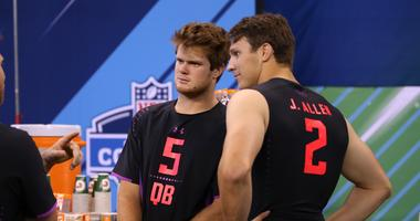 Mar 3, 2018; Indianapolis, IN, USA; USC Trojans quarterback Sam Darnold (5) talks with Wyoming Cowboys quarterback Josh Allen (2) during the 2018 NFL Combine at Lucas Oil Stadium. Mandatory Credit: Brian Spurlock-USA TODAY Sports