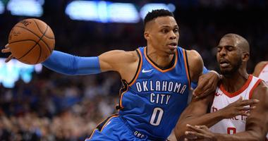 Mar 6, 2018; Oklahoma City, OK, USA; Oklahoma City Thunder guard Russell Westbrook (0) drives to the basket against Houston Rockets guard Chris Paul (3) during the fourth quarter at Chesapeake Energy Arena. Mandatory Credit: Mark D. Smith-USA TODAY Sports