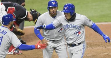 Apr 13, 2018; Cleveland, OH, USA; Toronto Blue Jays shortstop Aledmys Diaz (right) celebrates with third baseman Yangervis Solarte (26) and center fielder Kevin Pillar (11) after hitting a three-run home run in the fourth inning.