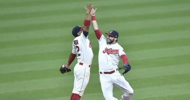 Apr 30, 2018; Cleveland, OH, USA; Cleveland Indians shortstop Francisco Lindor (12) and center fielder Tyler Naquin (30) celebrate a win over the Texas Rangers at Progressive Field.