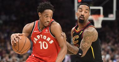 Toronto Raptors guard DeMar DeRozan (10) drives to the basket against Cleveland Cavaliers guard JR Smith (5) during the first half in game three of the second round of the 2018 NBA Playoffs at Quicken Loans Arena.