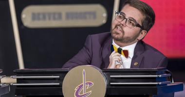 Nick Gilbert, son of Cavs owner Dan Gilbert, adjusts his wooden tie during the 2018 NBA Draft Lottery at the Palmer House Hilton