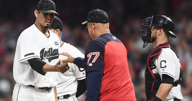 Cleveland Indians manager Terry Francona (77) relieves Cleveland Indians starting pitcher Carlos Carrasco (59) during the sixth inning against the Houston Astros at Progressive Field.