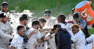 May 27, 2018; Cleveland, OH, USA; Cleveland Indians center fielder Greg Allen (1) is doused with water after hitting a game-winning home run in the fourteenth inning against the Houston Astros at Progressive Field.