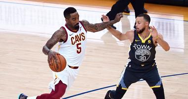Jun 3, 2018; Oakland, CA, USA; Cleveland Cavaliers guard JR Smith (5) moves the ball against Golden State Warriors guard Stephen Curry (30) during the first half in game two of the 2018 NBA Finals at Oracle Arena