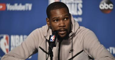 Jun 6, 2018; Cleveland, OH, USA; Golden State Warriors forward Kevin Durant (35) speaks to the media after game three of the 2018 NBA Finals at Quicken Loans Arena.