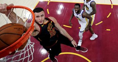 Cleveland Cavaliers forward Larry Nance Jr. (22) dunks the ball against Golden State Warriors forward Draymond Green (23) during the second quarter in game four of the 2018 NBA Finals