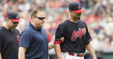 Jun 16, 2018; Cleveland, OH, USA; Cleveland Indians starting pitcher Carlos Carrasco (59) is led off the field after being injured during the second inning against the Minnesota Twins at Progressive Field.