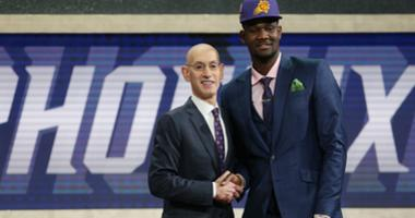 eandre Ayton (Arizona) greets NBA commissioner Adam Silver after being selected as the number one overall pick to the Phoenix Suns first round of the 2018 NBA Draft at the Barclays Center.