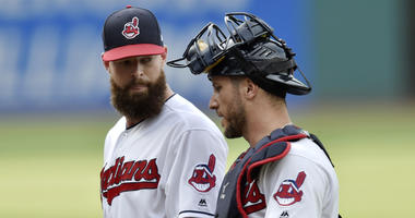 Jul 12, 2018; Cleveland, OH, USA; Cleveland Indians starting pitcher Corey Kluber (28) talks with catcher Yan Gomes (7) in the first inning against the New York Yankees at Progressive Field.