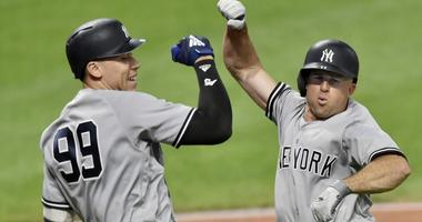 New York Yankees left fielder Brett Gardner (right) celebrates with right fielder Aaron Judge (99) after hitting a solo home run in the ninth inning against the Cleveland Indians at Progressive Field.
