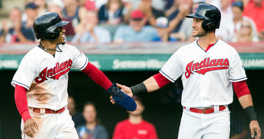 Jul 13, 2018; Cleveland, OH, USA; Cleveland Indians shortstop Francisco Lindor (12) and catcher Yan Gomes (7) celebrate after scoring during the second inning against the New York Yankees at Progressive Field.