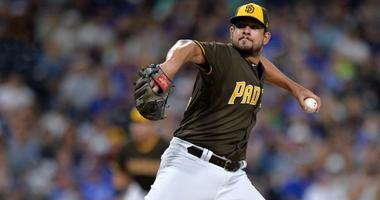 San Diego Padres relief pitcher Brad Hand (52) pitches during the ninth inning against the Chicago Cubs at Petco Park.