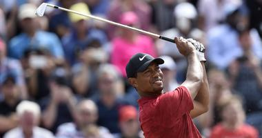 Tiger Woods plays his shot from the third tee during the final round of The Open Championship golf tournament at Carnoustie Golf Links.