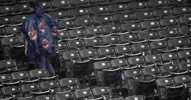 Jul 23, 2018; Cleveland, OH, USA; A fan walks in the stands during a rain delay of a game between the Cleveland Indians and the Pittsburgh Pirates at Progressive Field. Mandatory Credit: David Richard-USA TODAY Sports