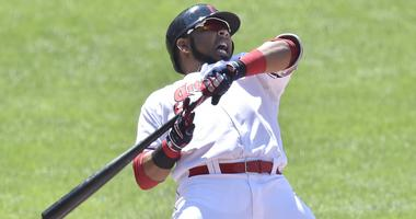 Cleveland Indians designated hitter Edwin Encarnacion (10) reacts after an inside pitch in the eighth inning against the Pittsburgh Pirates at Progressive Field.