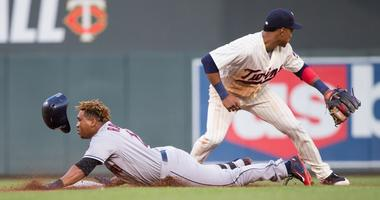Cleveland Indians third baseman Jose Ramirez (11) doubles in the third inning against Minnesota Twins at Target Field.