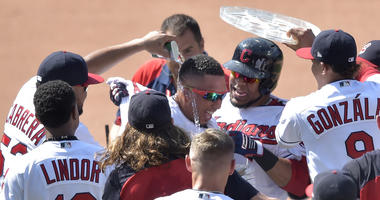 Aug 9, 2018; Cleveland, OH, USA; Cleveland Indians left fielder Michael Brantley (23), center, celebrates his game-winning single in the ninth inning against the Minnesota Twins at Progressive Field.