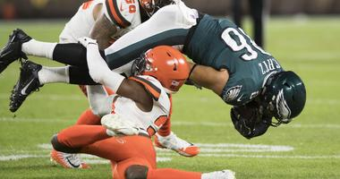 Cleveland Browns cornerback Denzel Ward (21) tackles Philadelphia Eagles tight end Zach Ertz (86) during the first quarter at FirstEnergy Stadium. Ward was injured on the play.