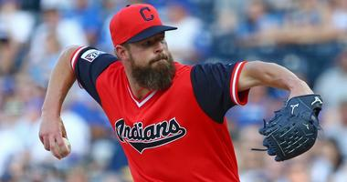 Cleveland Indians starting pitcher Corey Kluber (28) throws a pitch during the first inning against the Kansas City Royals at Kauffman Stadium.