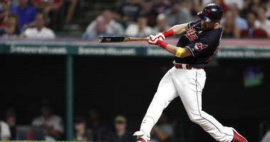 Sep 1, 2018; Cleveland, OH, USA; Cleveland Indians pinch hitter Jason Kipnis (22) hits a solo home run during the ninth inning against the Tampa Bay Rays at Progressive Field.