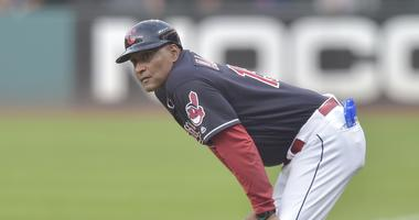 Sep 4, 2018; Cleveland, OH, USA; Cleveland Indians first base coach Sandy Alomar Jr. (15) reacts in the first inning against the Kansas City Royals at Progressive Field. Mandatory Credit: David Richard-USA TODAY Sports