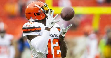Cleveland Browns wide receiver Josh Gordon (12) catches the ball during warmups before the game against the Pittsburgh Steelers at FirstEnergy Stadium.