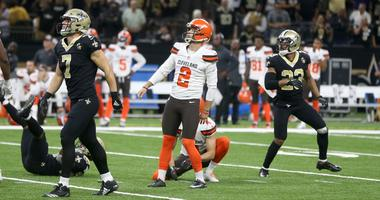 Cleveland Browns kicker Zane Gonzalez (2) watches his 52-yard field goal attempt with New Orleans Saints specialist Taysom Hill (7) and cornerback Marshon Lattimore (23) late in the fourth quarter at Mercedes-Benz Superdome.