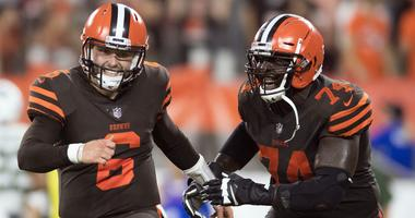 Cleveland Browns quarterback Baker Mayfield (6) and offensive guard Chris Hubbard (74) celebrate after a two-point conversion during the third quarter against the New York Jets at FirstEnergy Stadium.